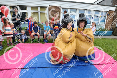 Newton Primary School, Swansea... Community fun and fundraising at the primary school's summer celebration.. Max Carman aged 7 (left) and Martin Lewis aged 7, sumo style.