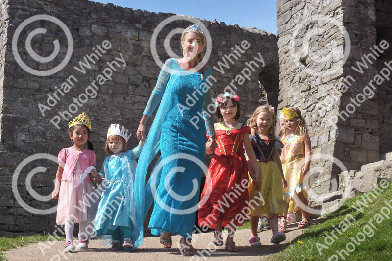 Princess Day at Oystermouth Castle, Mumbles. Castle coodinatorErika Kluge dressed as 'Elsa' and surrounded by royalty during the Princess Day at Oystermouth Castle.