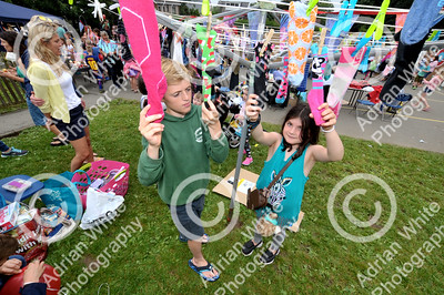 Newton Primary School, Swansea... Community fun and fundraising at the primary school's summer celebration.. Pupils, Ollie Price aged 13 and Heidi Bere aged 8 finding treasures in odd socks.