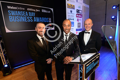 Wales Online Swansea Bay Business Awards at the Brangwyn Hall, Swansea...  Guest speaker Colin Jackson CBE with South Wales Evening Post Editor Jonathan Roberts (left) and Marketing Manager Marcus Boskey.  Copyright © 2018 by Adrian White Photography, all rights reserved. For permission to publish - contact me via www.adrianwhitephotography.co.uk Please respect copyright laws.