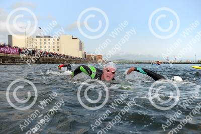 Swansea Triathlon 2019 Swansea Marina.  Wave 1 competitors in action in The Prince of Wales Dock.  Copyright © 2019 by Adrian White  Photography, all rights reserved. For permission to publish - contact me via www.adrianwhitephotography.co.uk Please respect copyright laws.