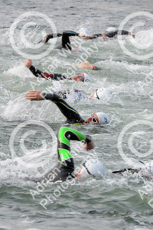 Swansea Triathlon 2019 Swansea Marina.  Wave 1 competitors in action.  Copyright © 2019 by Adrian White  Photography, all rights reserved. For permission to publish - contact me via www.adrianwhitephotography.co.uk Please respect copyright laws.