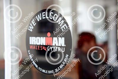 Tenby, West Wales prepares for this year's world renowned Ironman competition... Tenby United RFC bar window, Upper Frog Street, Tenby.