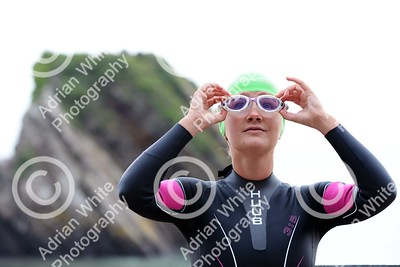 Tenby, West Wales prepares for this year's world renowned Ironman competition... Ironman competitor, Sarah Jones, from Bynea Cycling Club getting ready for her training swim from North Beach Tenby.