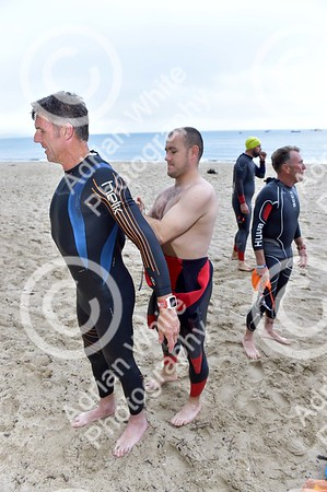 Tenby, West Wales prepares for this year's world renowned Ironman competition... Tenby Aces Cycle Club taking their final group training swim ahead of the Ironman this weekend.
