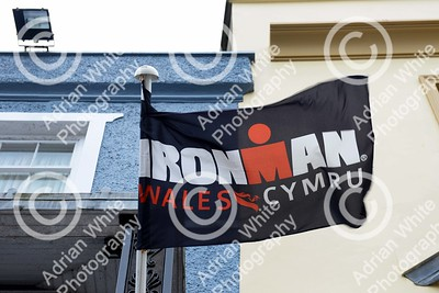 Tenby, West Wales prepares for this year's world renowned Ironman competition... Flags flying for this years Ironman in Tenby High Street.