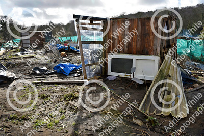 Allotmenteers in Pontypridd begin the clean up of their growing space following the wreckage to the Tin Plate Allotments by the burst banks of the River Taff brought by the rain and floods of Storm Dennis.  An upended allotment shed remains on it's side a week after the storm waters have ebbed away.  Copyright © 2020 by Adrian White  Photography, all rights reserved. For permission to publish - contact me via www.adrianwhitephotography.co.uk Please respect copyright laws.