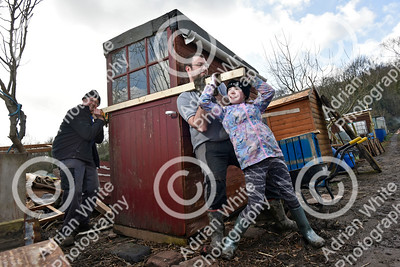 Allotmenteers in Pontypridd begin the clean up of their growing space following the wreckage to the Tin Plate Allotments by the burst banks of the River Taff brought by the rain and floods of Storm Dennis.  Malcolm Fraser, his son Gary and grand daughter Isobel Fraser help to right their allotment shed tipped over in the storm.  Copyright © 2020 by Adrian White  Photography, all rights reserved. For permission to publish - contact me via www.adrianwhitephotography.co.uk Please respect copyright laws.