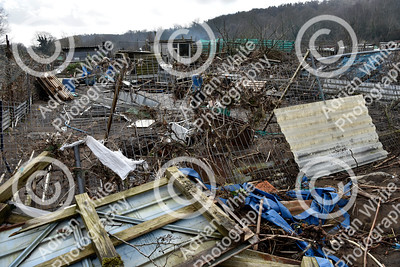 Allotmenteers in Pontypridd begin the clean up of their growing space following the wreckage to the Tin Plate Allotments by the burst banks of the River Taff brought by the rain and floods of Storm Dennis.  Copyright © 2020 by Adrian White  Photography, all rights reserved. For permission to publish - contact me via www.adrianwhitephotography.co.uk Please respect copyright laws.