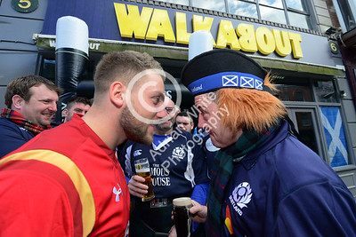 Wales v Scotland - Fans warming up for the match on Wind Street Swansea... Celtic Kiss - fans outside Walkabout.
