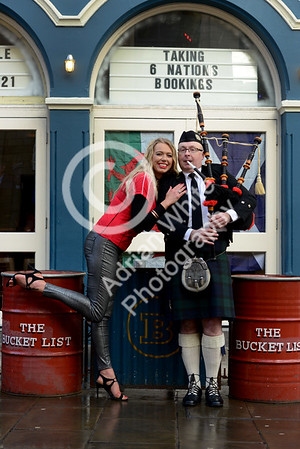 Wales v Scotland - Fans warming up for the match on Wind Street Swansea... Scots Piper Rob Wanless getting a warm welcome from Wales fan Hayley Legg