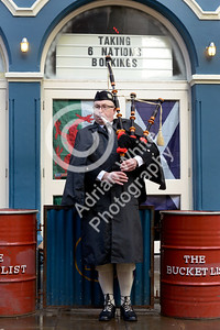 Wales v Scotland - Fans warming up for the match on Wind Street Swansea... Scots Piper Rob Wanless
