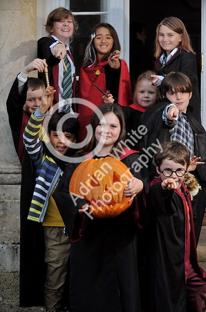 SWANSEA / Copyright Adrian White Tuesday 25th October 2016 Stouthall Country Mansion School of Witchcraft and Wizardry, Reynoldston, South Gower... Ruby Morse aged 11 from uplands (centre) lights up the twilight with her wizard friends in the grounds of Stouthall. BYLINE www.click4prints.com
