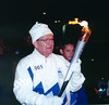 San Antonio, TX - SABCS 2001 _ Dr. Charles A Coltman, Jr. Director of the San Antonio Cancer Institute with the Olympic Torch he carried as the Winter Olympic Torch came through San Antonio, TX. Phot by Todd Buchanan 2001