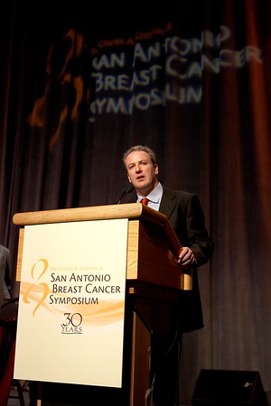 "San Antonio, TX -SABCS 2007: L to R: Stephen Stein, of Glaxo-SmithKline, announces the McGuire award to Dr. Mitchell Dowsett, of Institute of Cancer Research/Royal Marsden NHS Trust London, United Kingdom. Dowsett presented his paper on ""Biomarking the oestrogen dependence of breast cancer"" during the William L. McGuire Memorial Lecture at the San Antonio Breast Cancer Symposium here today, Friday December 14, 2007 in the Henry Gonzalez Convention Center. Over 8,000 physicians, researchers, clinicians, caregivers and cancer survivors from over 60 countries gathered to hear the latest developments in Breast Cancer research and treatment. Date: Friday December 14, 2007 Photo by © SABCS/Todd Buchanan 2007 Technical Questions: todd@toddbuchanan.com; Phone: 612-226-5154."