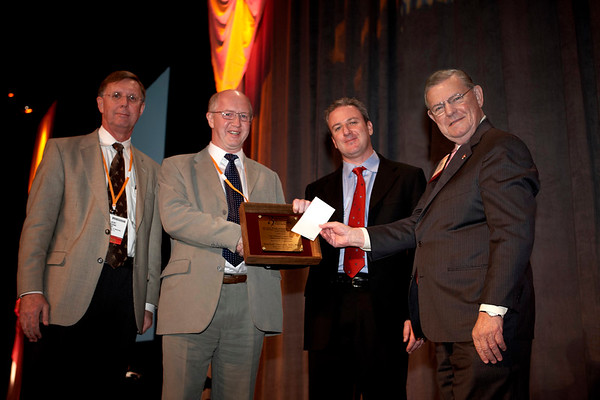 "San Antonio, TX -SABCS 2007: L to R: C.Kent Osborne, Mitchell Dowsett, Stephen Stein of Glaxo-Smith Kline and Charles Coltman present the McGuire award to Dr. Dowsett. Dowsett, of Institute of Cancer Research/Royal Marsden NHS Trust London, United Kingdom, presented his paper on ""Biomarking the oestrogen dependence of breast cancer"" during the William L. McGuire Memorial Lecture at the San Antonio Breast Cancer Symposium here today, Friday December 14, 2007 in the Henry Gonzalez Convention Center. Over 8,000 physicians, researchers, clinicians, caregivers and cancer survivors from over 60 countries gathered to hear the latest developments in Breast Cancer research and treatment. Date: Friday December 14, 2007 Photo by © SABCS/Todd Buchanan 2007 Technical Questions: todd@toddbuchanan.com; Phone: 612-226-5154."