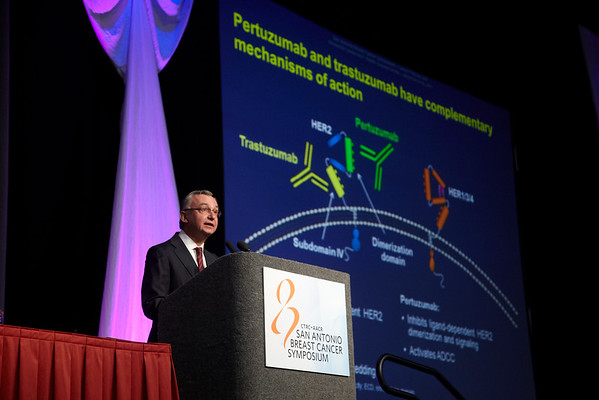 San Antonio, TX - SABCS 2011 San Antonio Breast Cancer Symposium: Jose Baselga MD, PhD discusses S5-5. A phase III, randomized, double-blind, placebo-controlled registration trial to evaluate the efficacy and safety of pertuzumab + trastuzumab + docetaxel vs. placebo + trastuzumab + docetaxel in patients with previously untreated HER2-positive metastatic breast cancer (CLEOPATRA) during the General Session 5 at the 2011 San Antonio Breast Cancer Symposium here today, Friday December 9, 2011. Over 9,000 physicians, researchers, patient advocates and healthcare professionals from over 90 countries attended the meeting which features the latest research on breast cancer treatment and prevention. Date: Friday December 9, 2011 Photo by © SABCS/Todd Buchanan 2011 Technical Questions: todd@medmeetingimages.com; Phone: 612-226-5154.