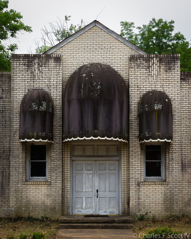 This started out as a church. In the 1980s it was converted to an auditorium. It was later donated to the city and eventually torn down.