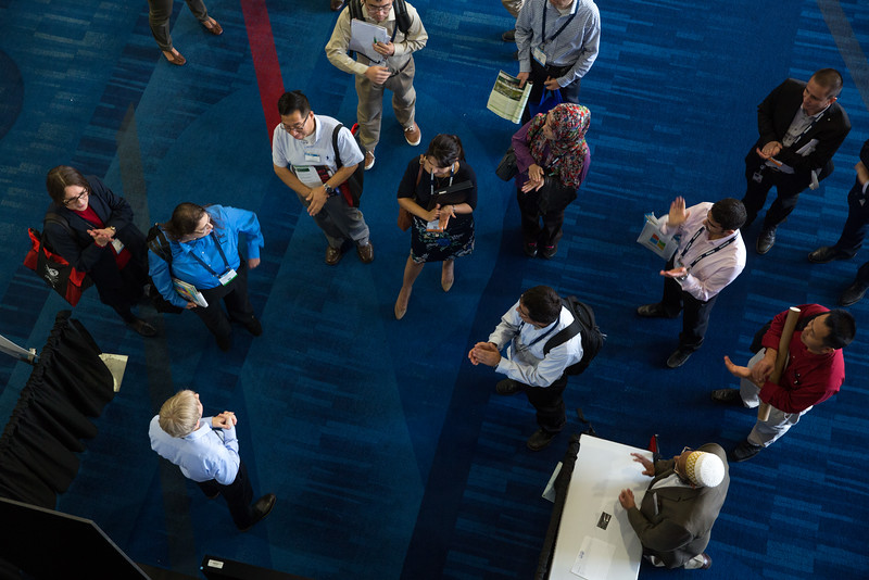 Poster presenters speaking E-Poster Session