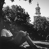 Man lounging in front of Hayes, University Archives, 1966, call number: 20A:22 (9)