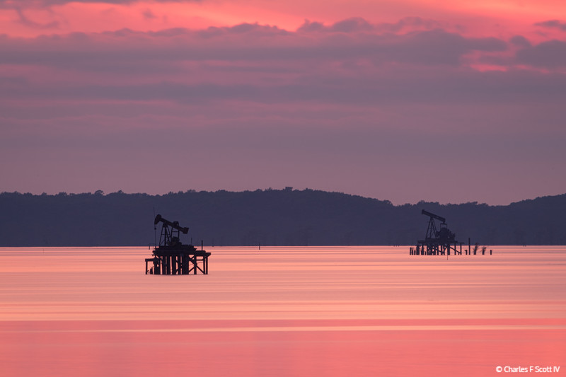 Caddo Lake oil derricks at sunset