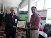 Photo of Joe Fowler with University R&D Showcase winner                                                            during University R&D Showcase Winner