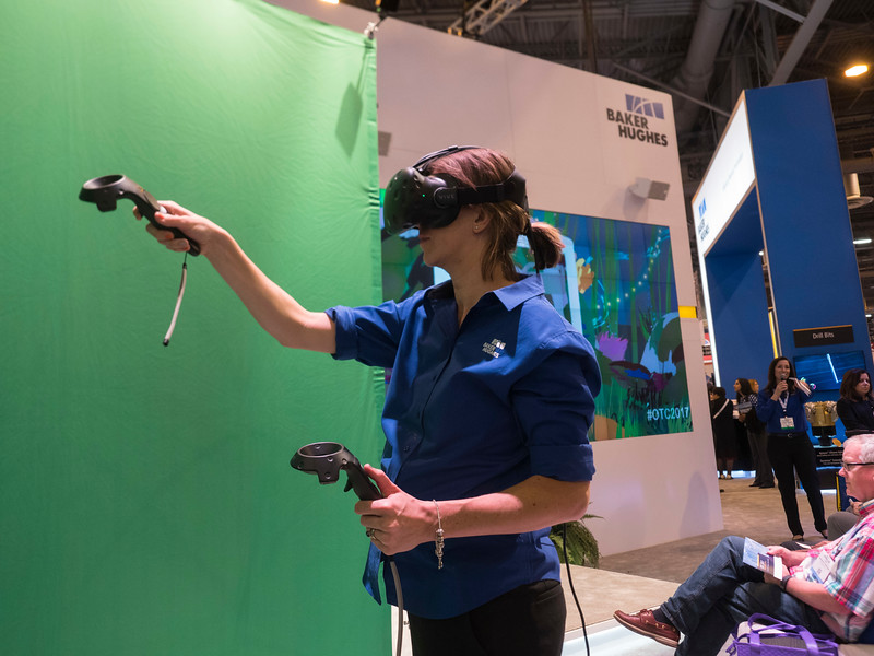 Interactive shots of people on floor, engaging in booths.  during Exhibition