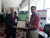 Photo of Joe Fowler with University R&D Showcase winner                                                            during University R&D Showcase Winner