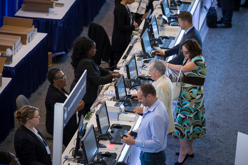 Wide angle and close up shots of people registering. during Registration