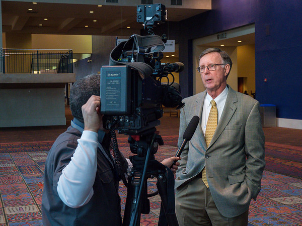 C. Kent Osborne, MD speaks to local media during the Tuesday workshops