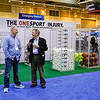 Attendees look over exhibit during One Sport Injury Booth
