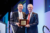 C Kent Osborne presents an award to Ian E. Smith, MD, FRCP, FRCPE during William L. Mcguire Memorial Lecture