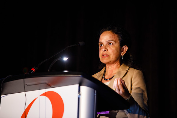 Reena Philip, PhD, speaks during Clinical Research workshop