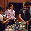 RED graduate students pick up business cards at tour's end