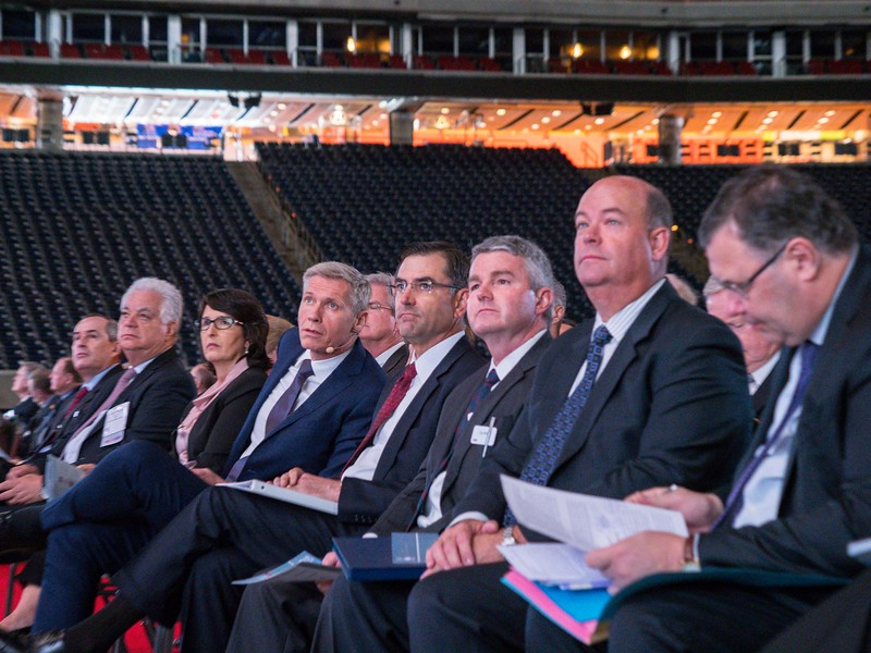 VIP Attendees listen to speakers during Opening Ceremony