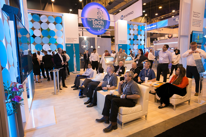 Attendees check out exhibits on the show floor  during