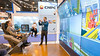 Attendees check out exhibits on the show floor  during demos at Jelec booth