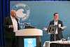 Mikael Leksell (with glasses) and Stig Olav Settemsdal, both from Siemens, speak during   during Topical Luncheon: Digitalization Deployed: The Ivar Aasen Field Development Project: The Pursuit of an Ultra-low Manned Platform Pays Dividends in the North Sea