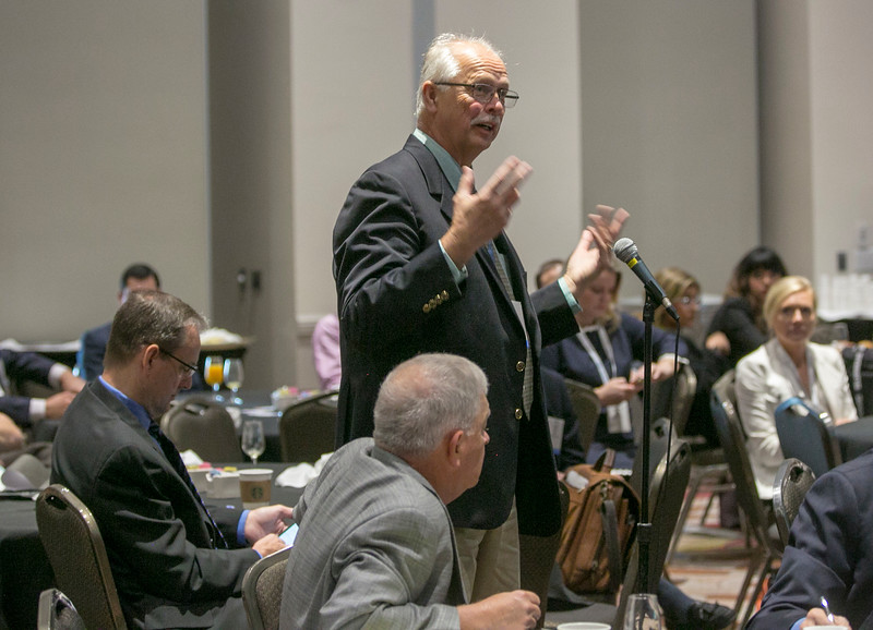 Buford Pollett, from University of Tulsa, and attendees during Topical Breakfast: Ethics Breakfast