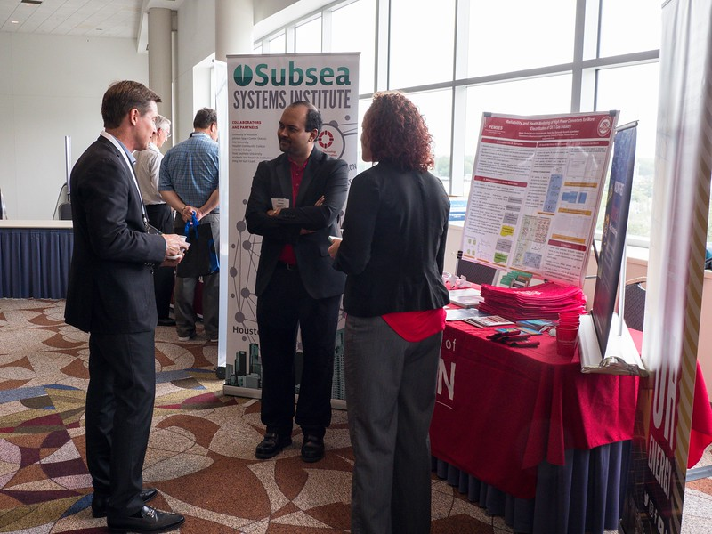 Attendees chat during University R&D Showcase
