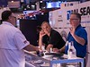 Attendees and Exhibitors chat during Exhibit Hall