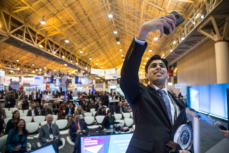 Harsh Vathsangam takes a selfie with the crowd after receiving his award during Future Hub Innovation Challenge-Artificial Intelligence