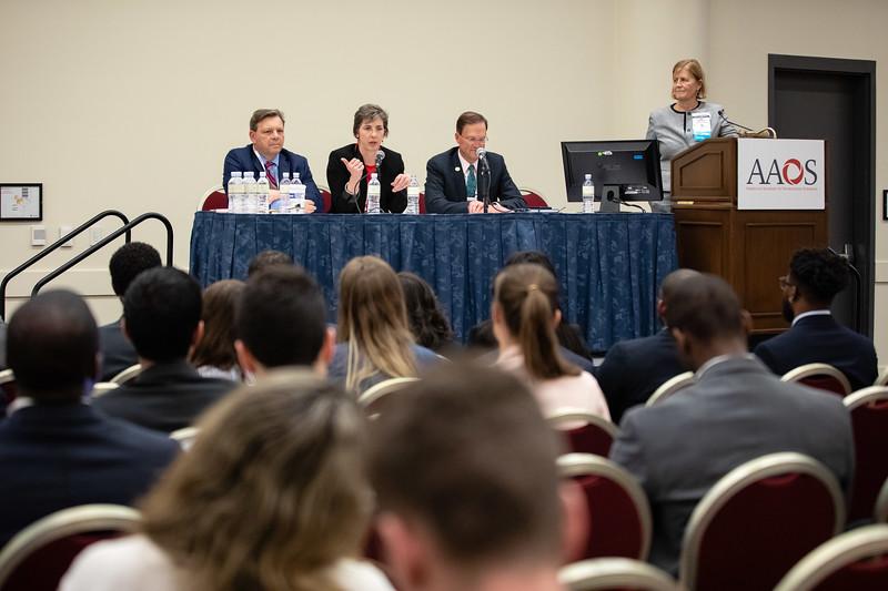 Joseph Bosco, Kristy Weber, and David Halsey talk to student attendees during Medical Student Program