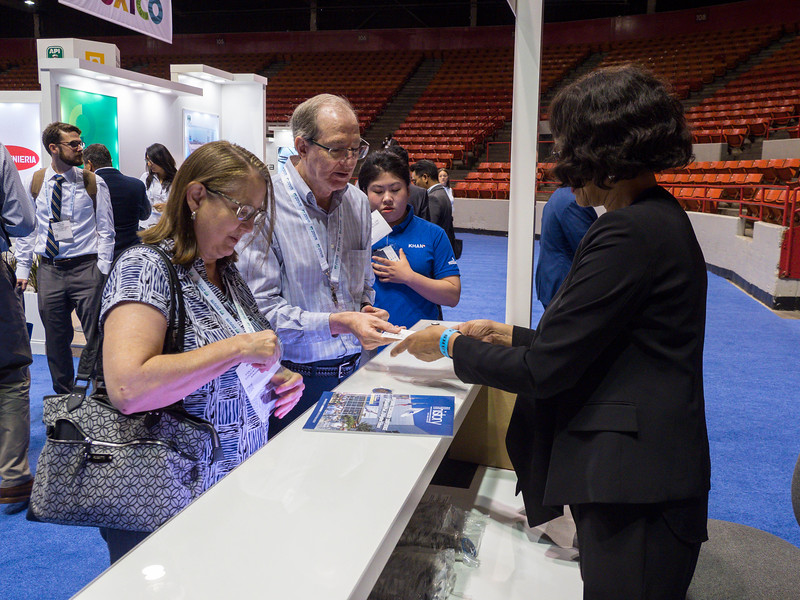 Attendees get 50th anniversary coins during exhibit hall sessions