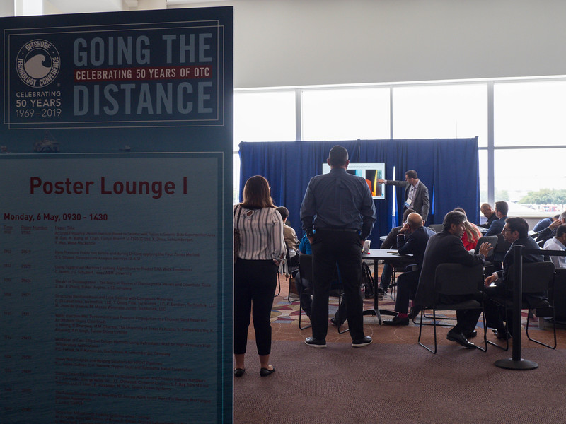 Speakers and attendees during OTC Poster Lounge