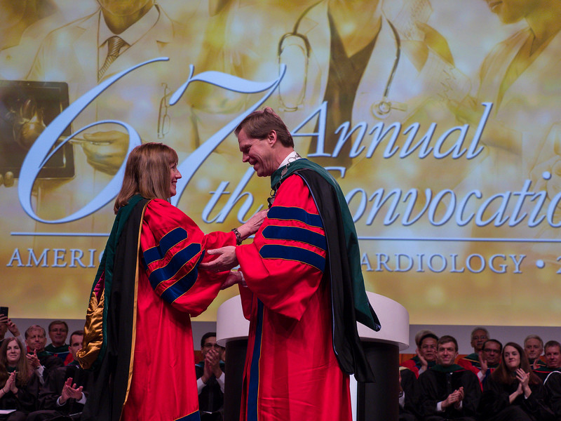 ACC President Walsh, Left, and In-coming Presiden Michael C Valentine exchance the mace during Convocation