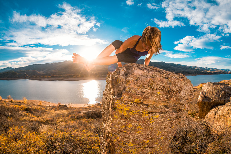 Andrea Bilderback does a yoga pose on top of the Gill Pinnacle near Fort Collins.