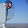 Leah Chomiak peers out a bubble window on NOAA 56