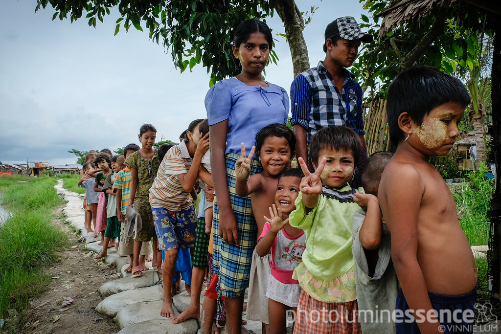 Village kids lining up for a biscuit handout