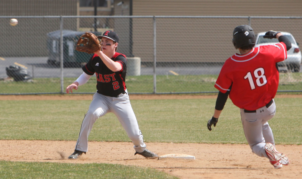 Jonathan Salistad of Duluth East makes the play at 2nd forcing Rocket Aaron Limberg out